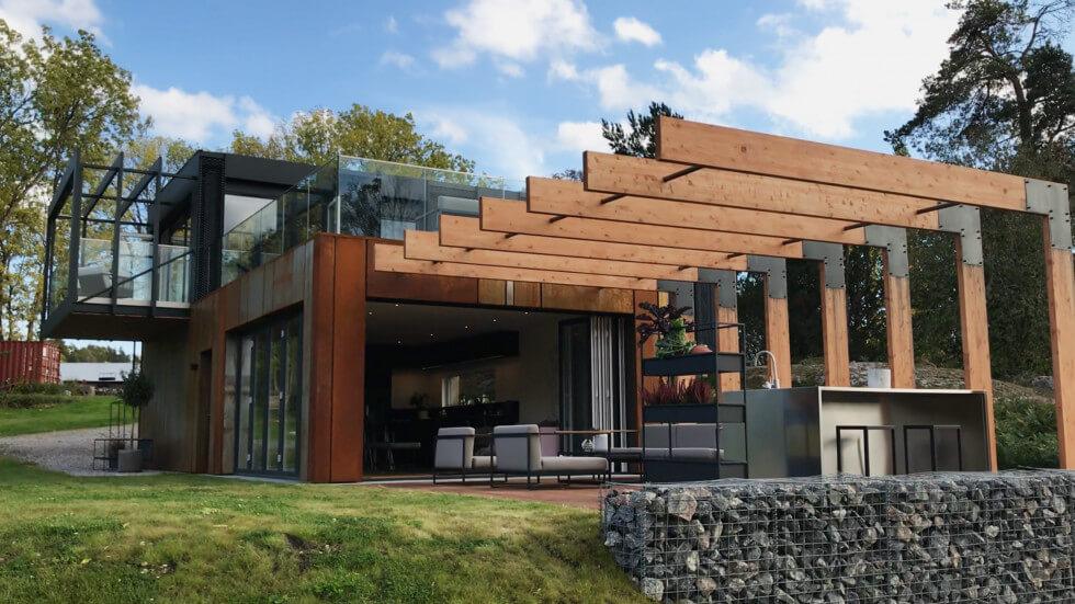 Containerhuset med en pergola av limträ.